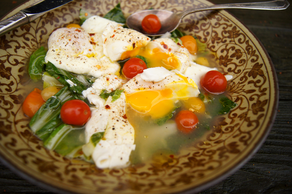 Bone broth with bok choy, poached eggs, and pickled cherry tomatoes