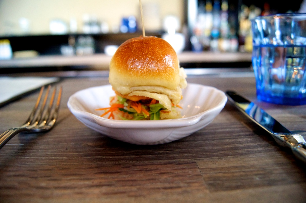 Crispy oyster slider on a Hawaiian roll