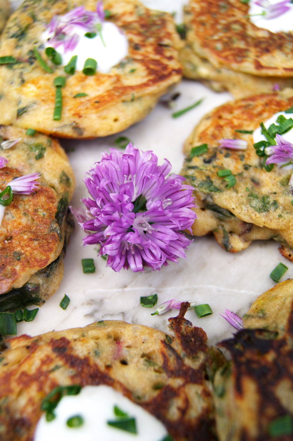 chard & saffron cakes with chive blossoms