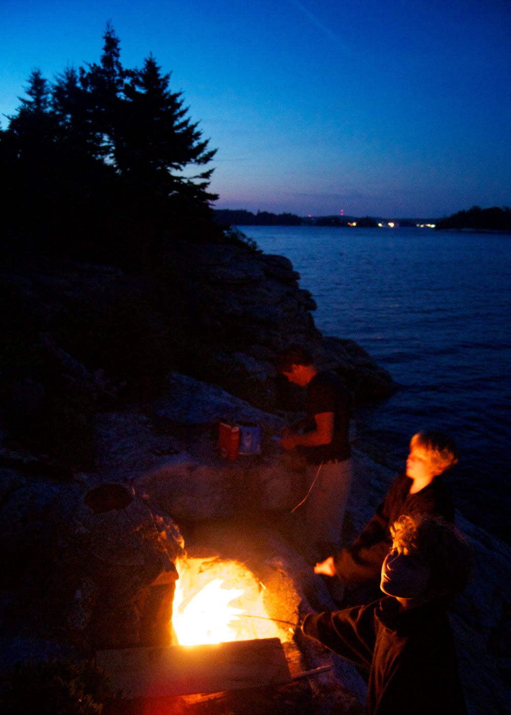 maine. campfire. s'mores. happy boys.