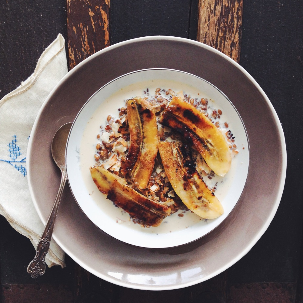 quinoa, amaranth, and brown rice porridge with caramelized banana and coconut